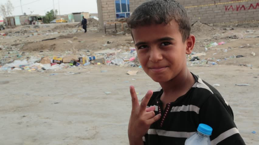 Basra, Iraq, October 2014: Middle Eastern Boy Gives a Peace Sign in Basra, Iraq, October 2014.