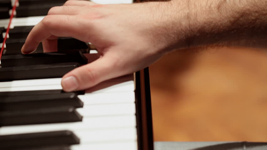 HD 1080 steadicam: Piano player playing piano; close up