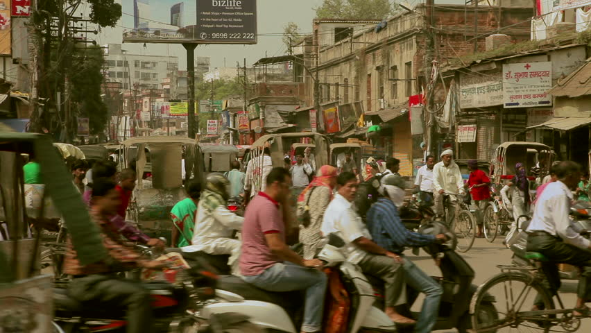 VARANASI,INDIA - October 29,2014 : Pedestrians walk in the middle of traffic jam on the streets of Varanasi,India