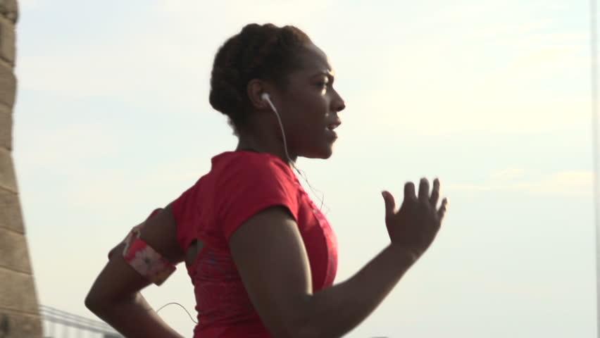 A female jogger on Brooklyn Bridge, New York - slow motion | Shutterstock HD Video #7973143