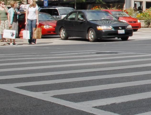 Crowds crossing urban street time lapse
