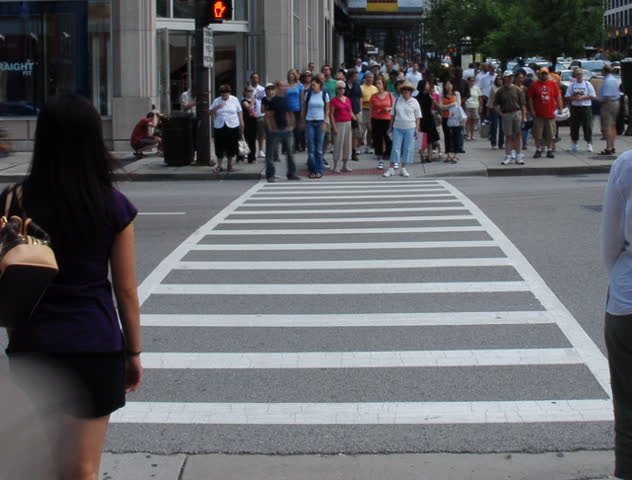 Crowds crossing urban street time lapse - SD stock footage clip