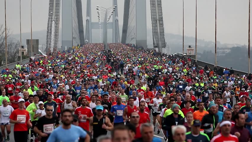 ISTANBUL, TURKEY - NOVEMBER 16: Competitors cross the Bosphorus Bridge that links Istanbul's European and Asian side during the 34th annual Euroasia Marathon on November 16, 2014 in Istanbul, Turkey. - HD stock footage clip