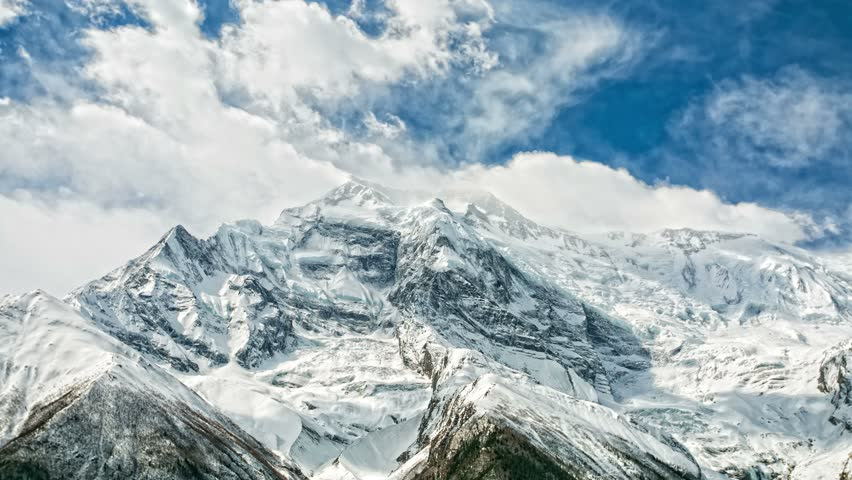 4k Timelapse of Annapurna II mountain, 7,937 m (26,040 ft). Nepal, Himalayas. Annapurna II is a part of Annapurna circuit trek, one of the most popular adventure circuit trek in the world. | Shutterstock HD Video #8051308