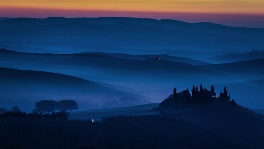 Sunrise over foggy valley in Tuscany 4k timelapse