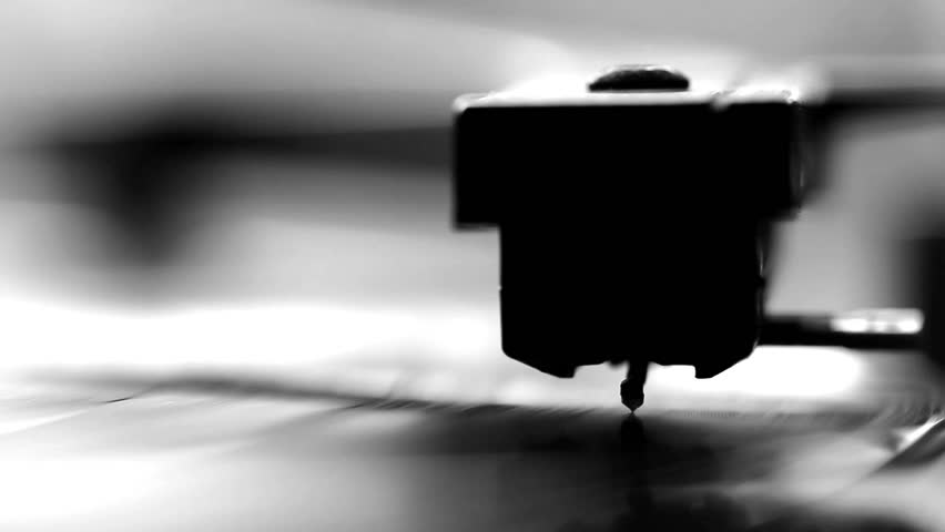 Close up of vintage gramophone needle playing, black and white video