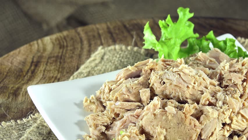Portion of Canned Tuna (not seamless loopable 4K UHD footage) - 4K stock footage clip