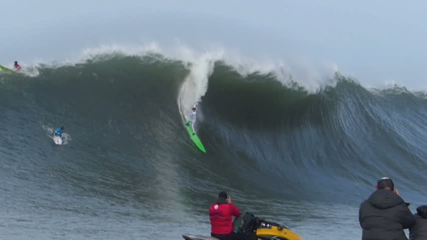 Half Moon Bay, California, USA  Jan. 24, 2014: Professional Surfer, Nic Lamb crashes while surfing on a giant wave during the Mavericks Invitational surf competition.