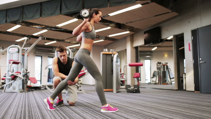 Sport, fitness, lifestyle, weightlifting and people concept - woman and personal trainer doing lunge with barbell and flexing muscles in gym | Shutterstock HD Video #8107468