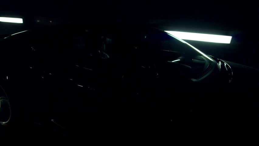Aston Martin in a light tunnel in London. Moving at night