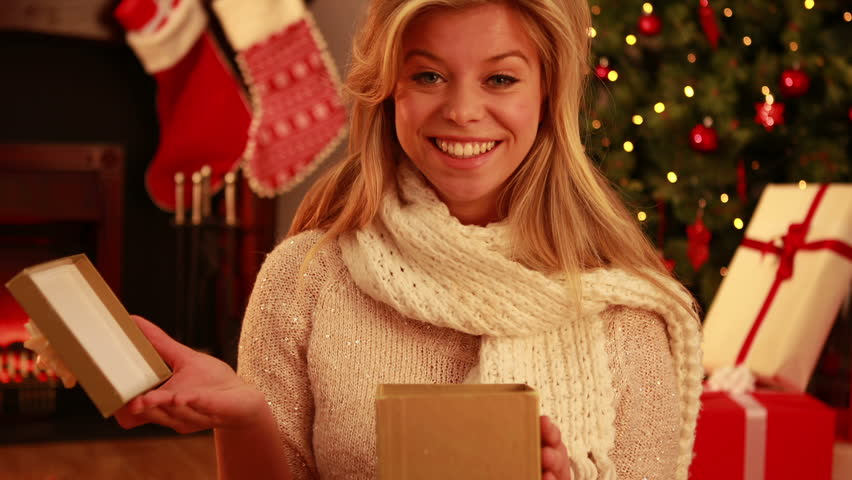 Pretty blonde opening gift at christmas in high quality 4k format | Shutterstock HD Video #8143981