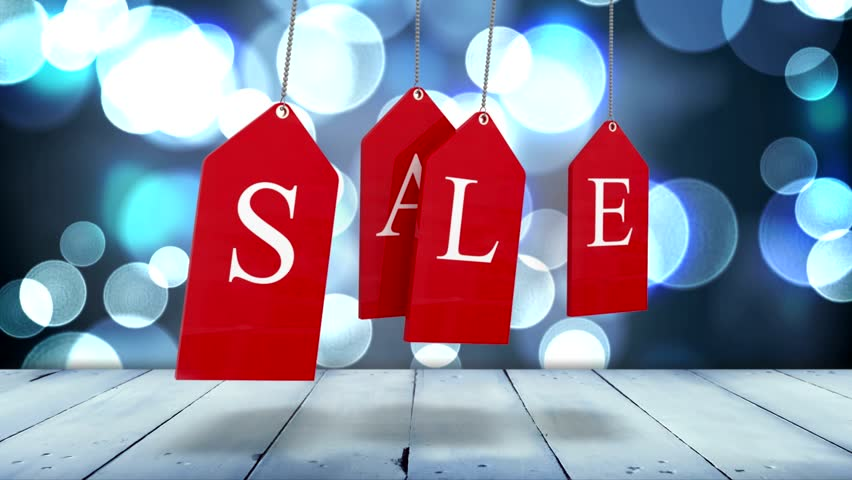 Digital animation of Red sale tags hanging against glowing background