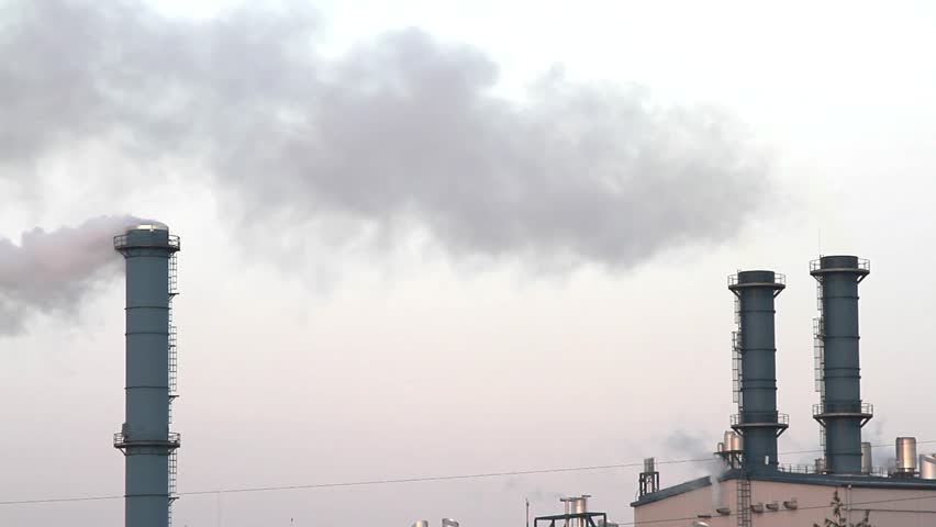Smoke from factory chimneys over grey sky and clouds. Industrial pollution. - HD stock footage clip