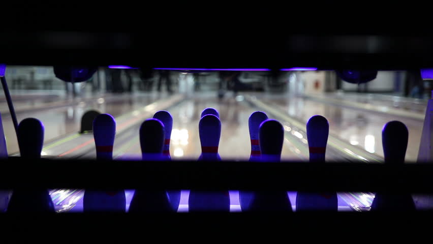 Bowling pin setter in bowling alley