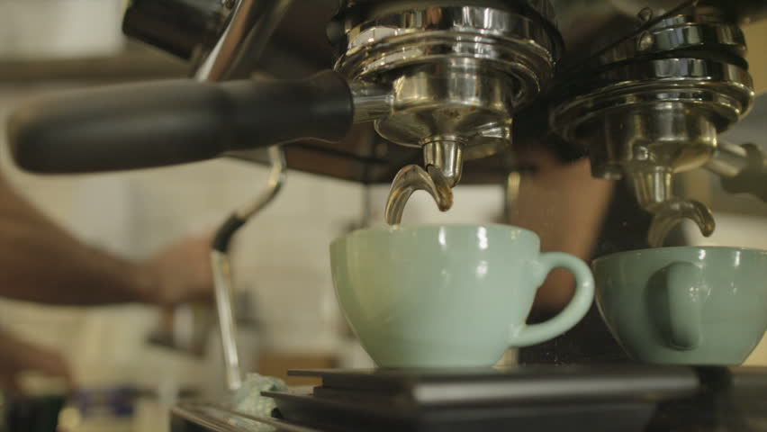 Preparing and serving fresh coffee at an upmarket Cafeteria - HD stock video clip