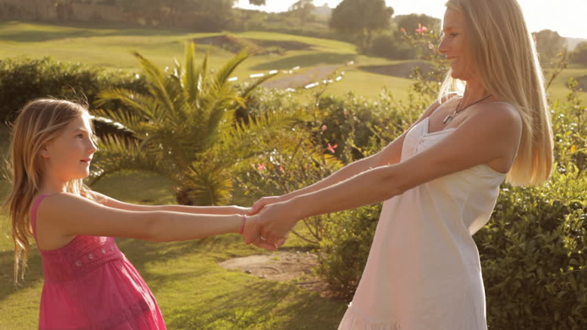 Mother And Daughter Spinning Round - HD stock footage clip