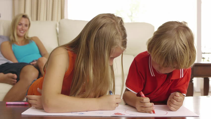 Brother And Sister Coloring Together In Living Room. - HD stock footage clip