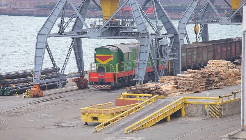 November 26 - 2014 Odessa, Ukraine. The shunting locomotive of ChME-3 goes on the mooring of the Odessa seaport and transports to the car on loading under cranes. Odessa seaport Ukraine.