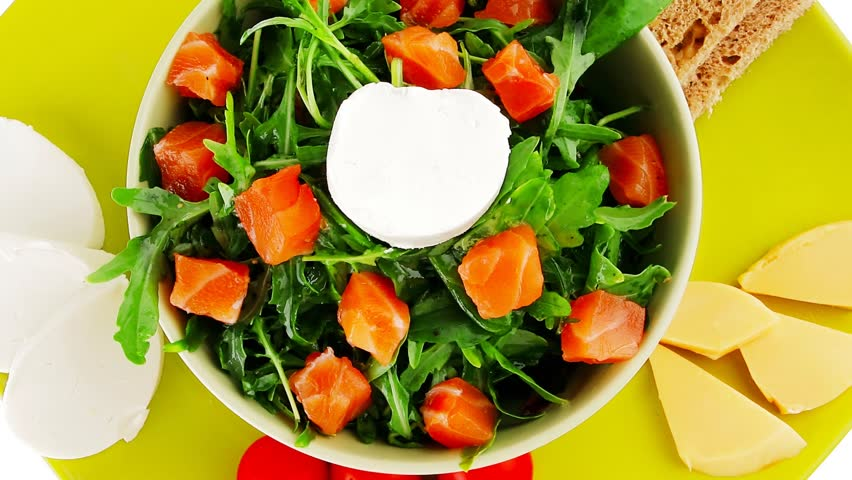 green salad with salmon and tomatoes on plate 1920x1080 intro motion slow hidef hd