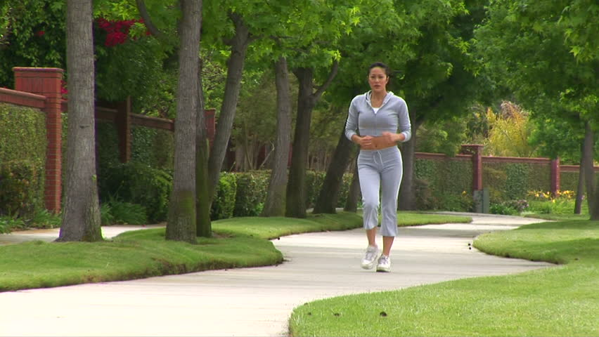 Young woman speed walking - HD stock video clip