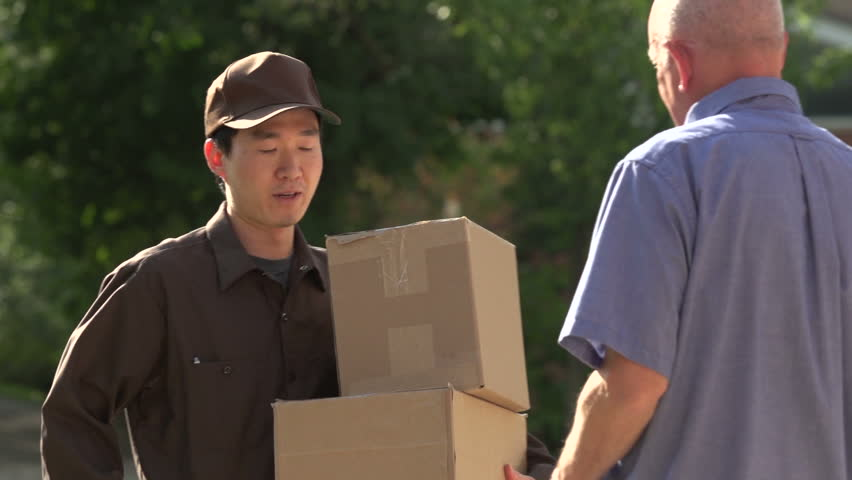 Delivery man delivering packages to customer