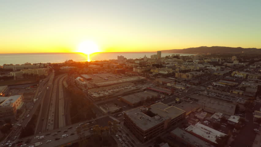 Low flying LA aerial over Santa Monica and Pier after sunset. #8256364