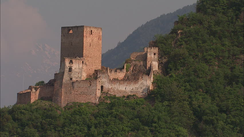 Aerial view over ruins of old castle in Italy, Tirol, Alps