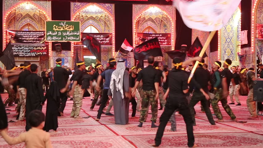 KARBALA, IRAQ - NOV 19, 2014: Iraqi soldiers mourns for Imam Hussein inside Hussein's shrine. The Shrine of Hussein is one of the oldest mosques in the world and a holy site of Muslim Shia.
