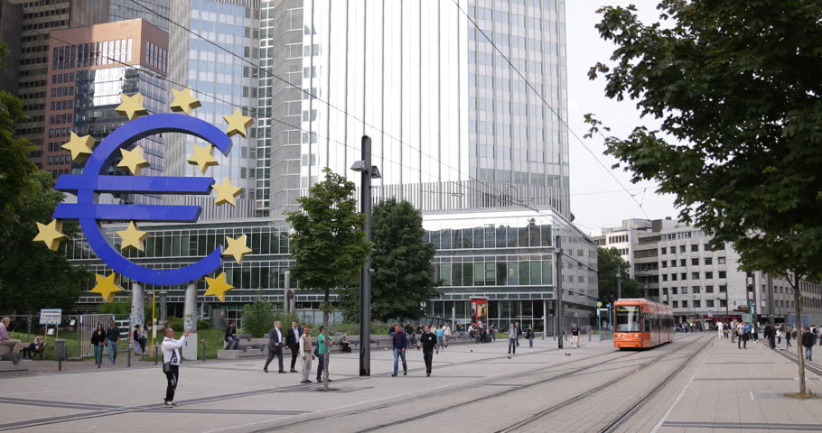 FRANKFURT, GERMANY - JULY 8, 2014 Modern Tram Pass in Famous German City Symbol Euro Sign Frankfurt People Walk ( Ultra High Definition, UltraHD, Ultra HD, UHD, 4K, 2160P, 4096x2160 )