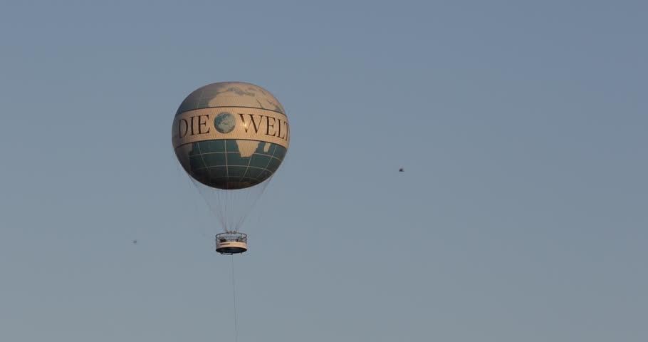 BERLIN, GERMANY - JUNE 30, 2014 Hot Air Balloon Pass Float Fly Berlin Trip Flight Die Welt Tourists Ride ( Ultra High Definition, UltraHD, Ultra HD, UHD, 4K, 2160P, 4096x2160 )