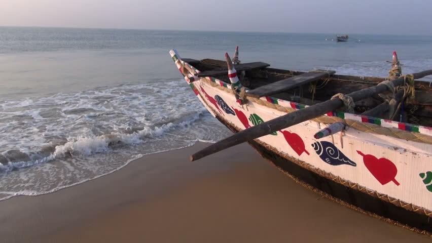 beautiful ornamental wooden fishing boat on Arabian sea beach in Odisha, India - HD stock footage clip