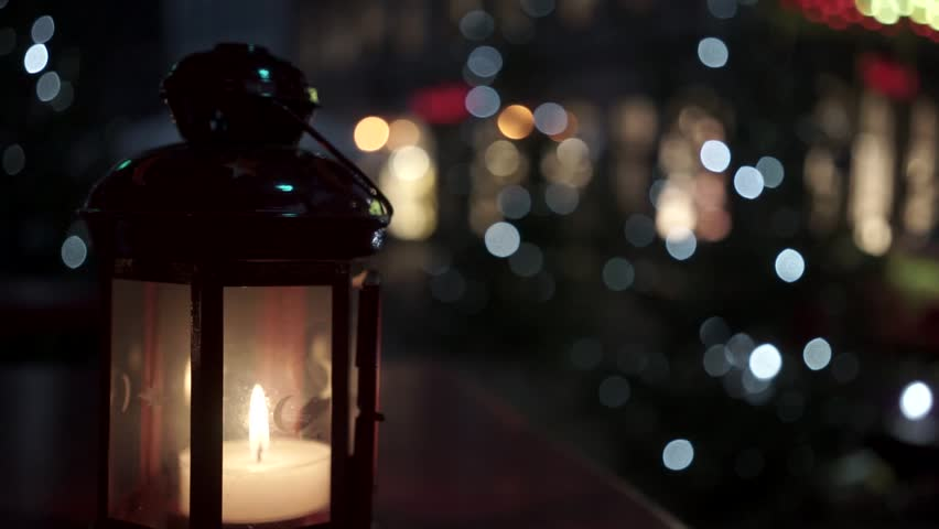 Candle burning in the street in December before the New Year