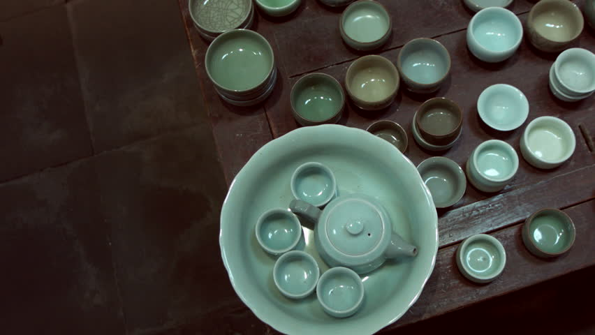 Many Chinese teacups in antique shop in Shanghai.A local seller of new and antique tea cups and tea sets. - HD stock video clip