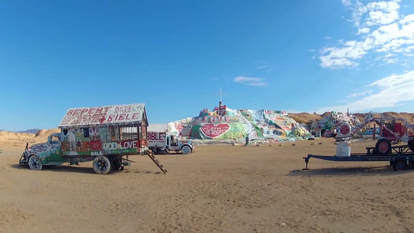 NILAND, CA: December 6, 2014- Wide shot of the Salvation Mountain site circa 2014 in Niland California. Thousands of gallons of paint and other materials form a tribute to God's love for humanity.
