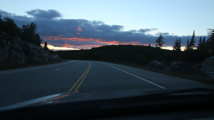Driving in Northern Ontario. Twilight clouds. Driving on HWY 17 east of Kenora in Northern Ontario, Canada.