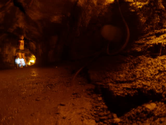 Volcanoes National Park, Hawaii - May, 2014 - Panning timelapse of tourists walking towards the exit of the Thurston Lava Tube.