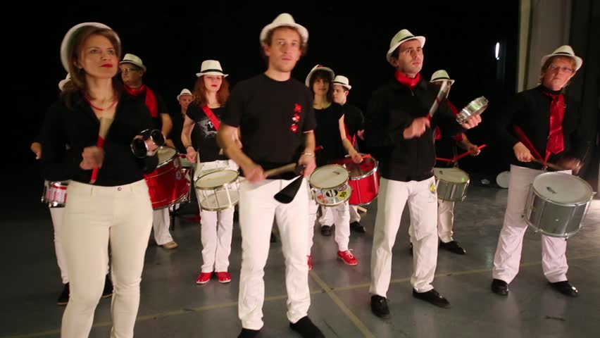 Musical group of thirteen people play drums on stage - HD stock video clip