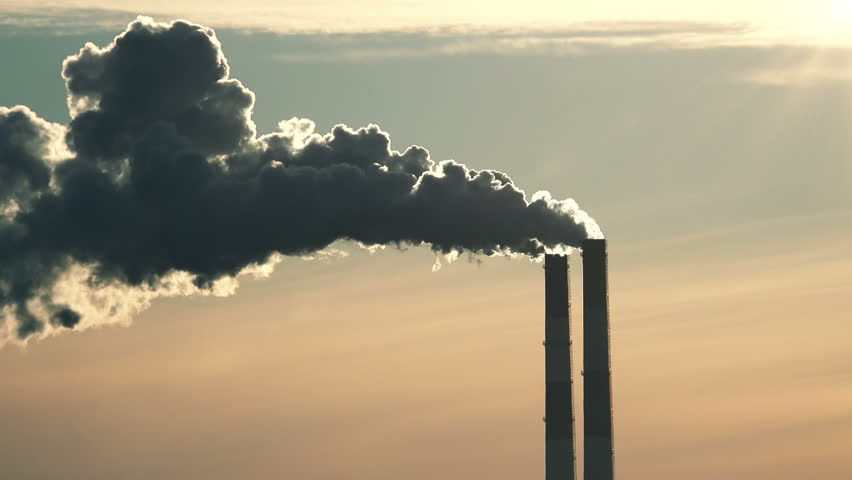 Chimneys of Power Plant at Sunset. Air Pollution Concept. 4K Ultra HD 3840x2160 Video Clip