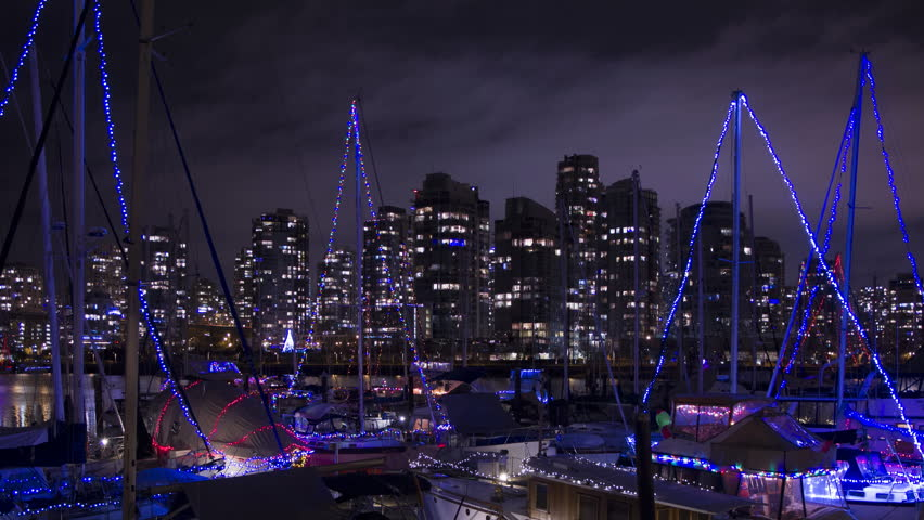 Vancouver holiday boats time lapse night. Condos in the background.