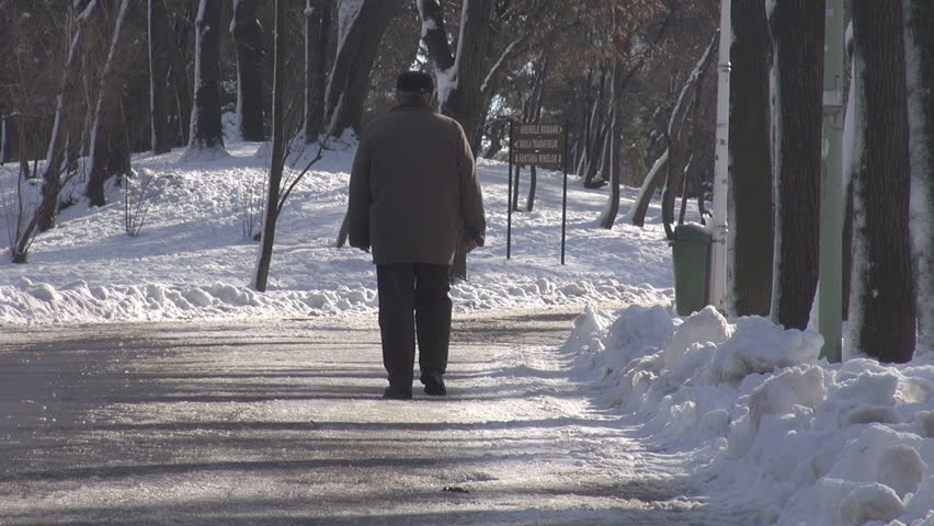 Old man walking in park alley in winter season, snowdrifts and sliding ice, cold   Shutterstock HD Video #8428300