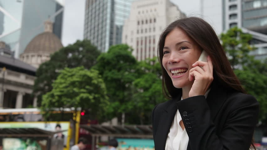 Asian Businesswoman Talking On Smartphone Stock Footage