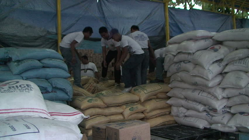 MANILA, PHILIPPINES - OCTOBER 2009: Soldiers Prepare Food Aid After Disaster In Philippines