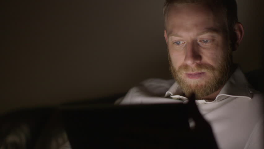 Man working late into the night from home. - HD stock footage clip