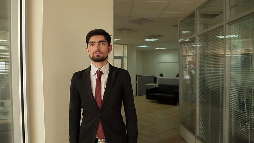 businessman is walking around office building.  - HD stock footage clip