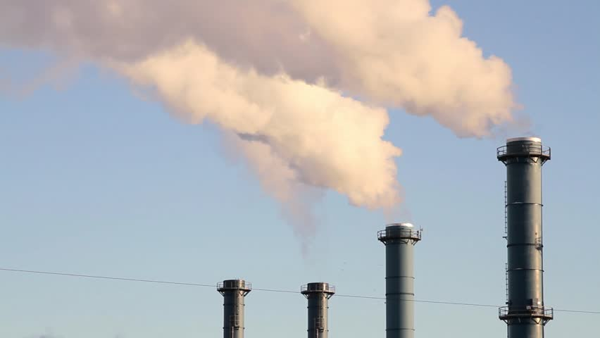 Smoke from factory over blue sky. Industrial pollution. - HD stock footage clip