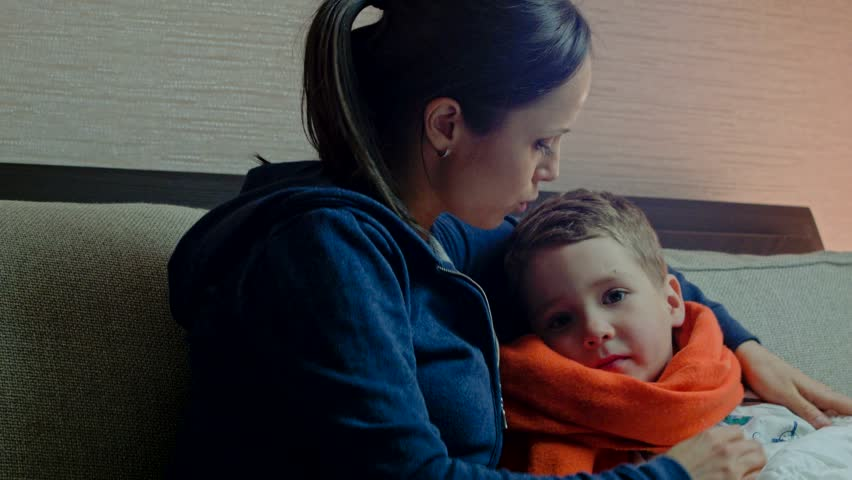 young mother gives her sick son medicine in bed stock footage video 8603524 shutterstock. Black Bedroom Furniture Sets. Home Design Ideas