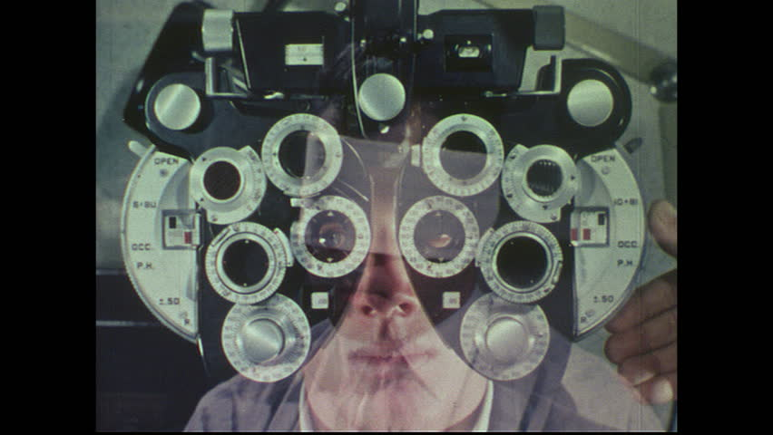 UNITED STATES 1960s: Man looking through phoropter / Hand changes lenses / Man at microphone, man recording in background / Man speaks into microphone / Eye chart with man in foreground.