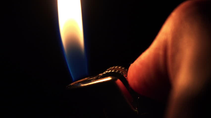 Using a Lighter at Night with Sparkles. 4K Ultra HD 3840x2160 Video Clip