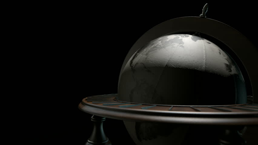 A static view of a vintage wooden world globe ornament spinning on an isolated backlit dark background | Shutterstock HD Video #8629504