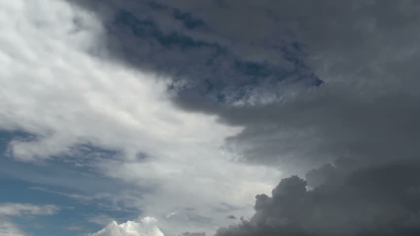 Time Lapse, Dark, stormy clouds creep across sky like a shroud. 1920x1080 - HD stock footage clip